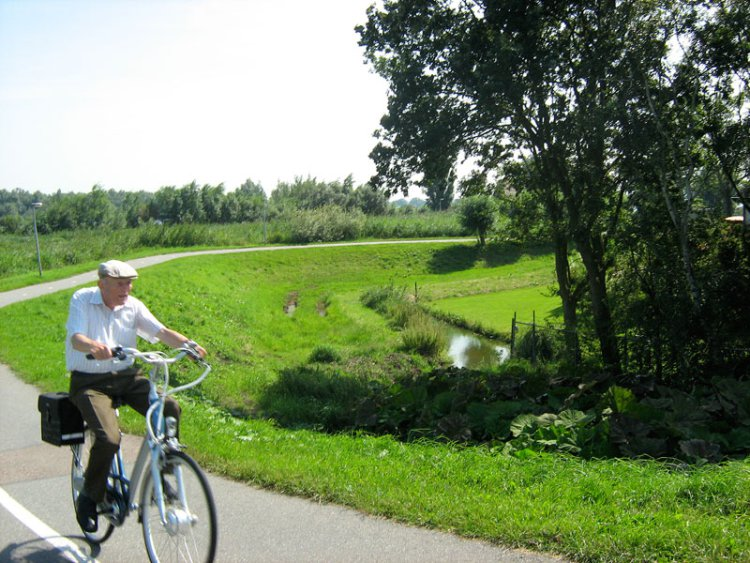 elderly-man-rides-in-countryside